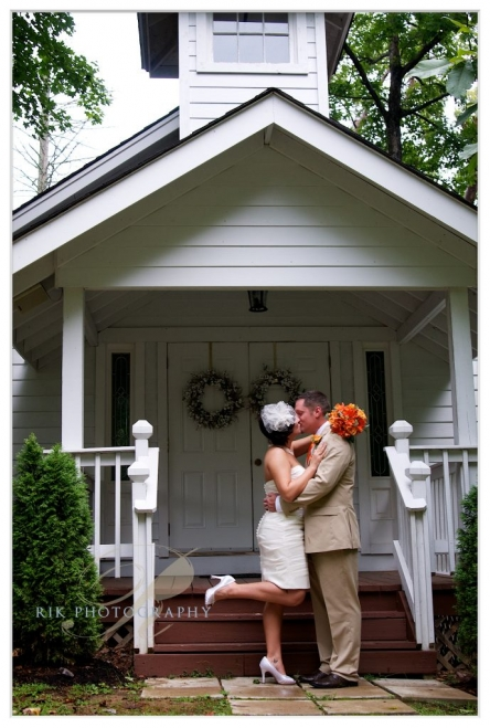 B&G kissing by the Gatlinburg Wedding chapel