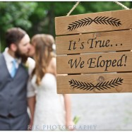 they eloped sign with b&g kissing in background